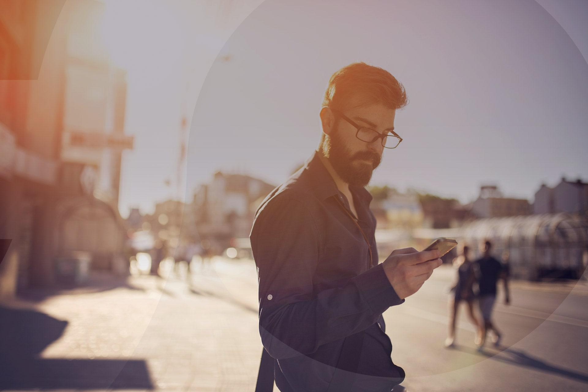 MoneySuperMarketGo photo of man looking at mobile phone